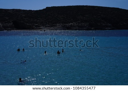 https://thumb7.shutterstock.com/display_pic_with_logo/167494286/1084355477/stock-photo-blue-lagoon-in-malta-island-1084355477.jpg