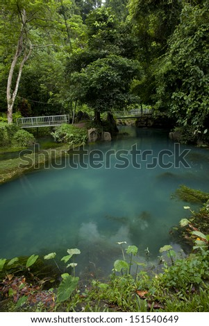 blue lagoon in Vang Vieng, Laos, travel destination with clear water and tropical landscape