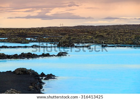 Blue lagoon waters in the lava field landscape of Iceland in winter - stock photo
