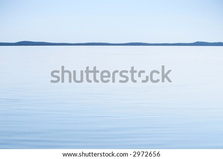 blue lagoon with distant skyline - stock photo