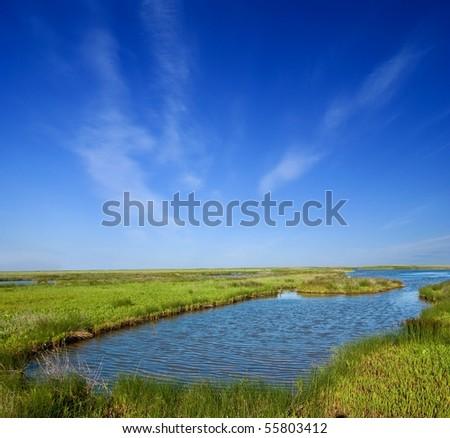 blue lake among a green fields - stock photo