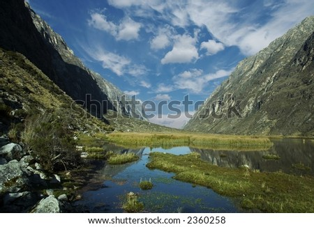 Blue lake and white clouds in Cordilleras mountain - stock photo
