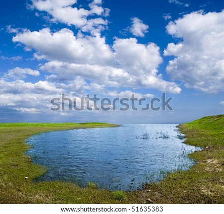 blue lake by a spring - stock photo