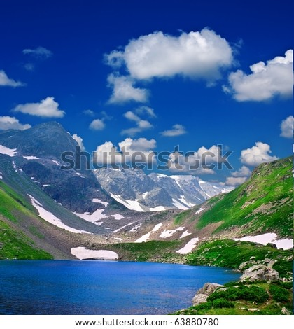 blue lake in a mountains bowl - stock photo
