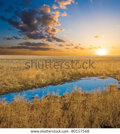 blue lake in a steppe at the evening - stock photo