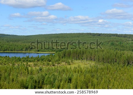 Blue Lake in mountains. Northern Finland, Lapland - stock photo