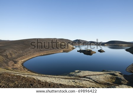 Blue lake, sky and stillness in Iceland - stock photo