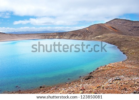 Blue lake - Tongariro Alpine crossing - most spectacular tramping track in New Zealand - stock photo