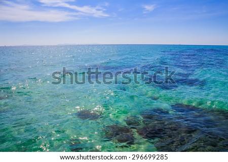 Blue landscape background sea surface backlit morning light - stock photo