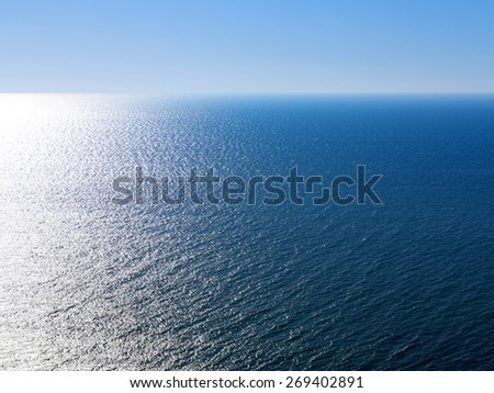 Blue landscape background sea surface backlit morning light of the setting sun in a wide range of brightness. For creative design