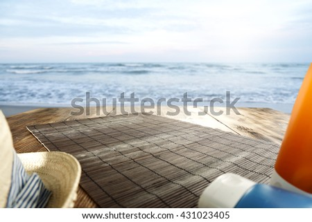 blue landscape of ocean with waves and hat and table