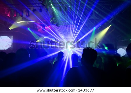 Blue laser at a night club. - stock photo