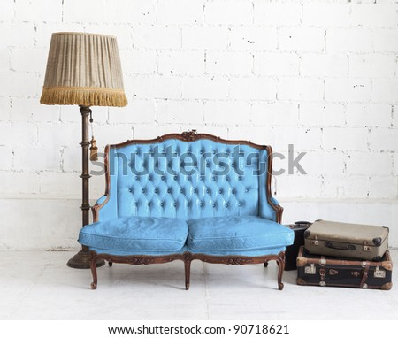 blue leather sofa in white room