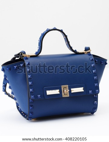 Blue leather women bag on the white background - stock photo