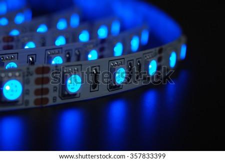 Blue led stripe on the black background - stock photo