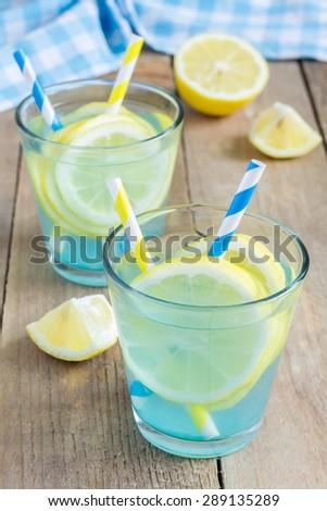 Blue lemonade with fresh lemons - stock photo