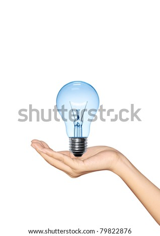 Blue Light bulb in hand woman on white background - stock photo