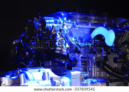 Blue light irradiation Auto engine of close-up - stock photo