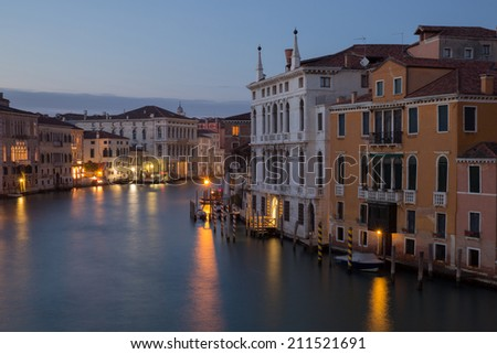 Blue light picture of Canal Grande in Venice with light reflection in water, Italy - stock photo