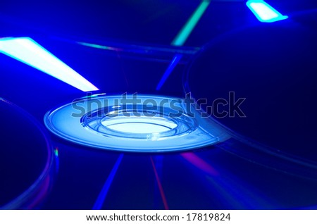 Blue light reflecting in the surface of a CD