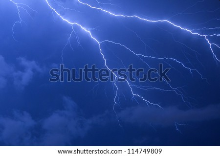 Blue lightning strike electrical storm after sundown in Florida - stock photo