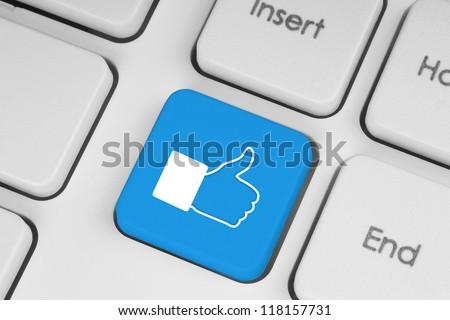 Blue like button on keyboard - stock photo