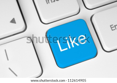 Blue like button on keyboard close-up - stock photo