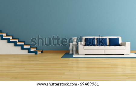 blue living room with staircase and modern white couch - stock photo