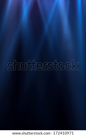 blue luminous rays on a dark background - stock photo