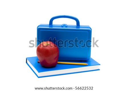 Blue lunch box and apple on a blue book isolated on white, School Lunches - stock photo