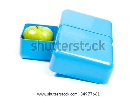 blue lunchbox with a green apple isolated on white - stock photo