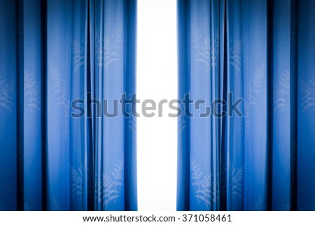 Blue luxury curtains with isolated on white background. - stock photo