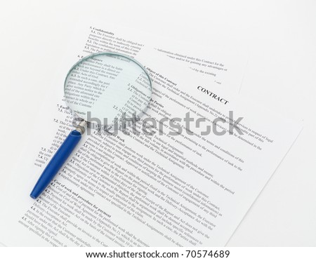 blue Magnifying Glass and document close up