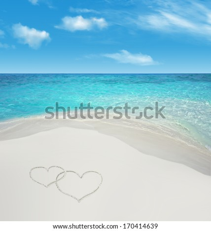 Blue Maldives water background with hearts on white sand.