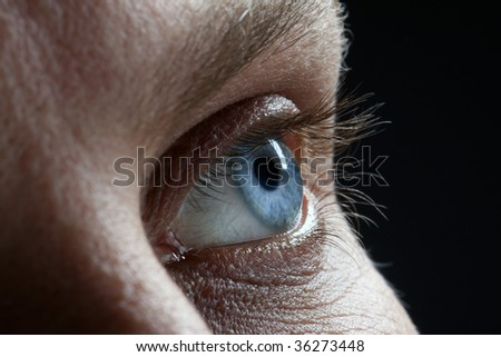 blue man Eye closeup - stock photo