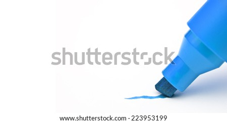 Blue marker drawing a line with blank space on the left - stock photo
