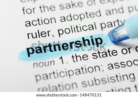 Blue marker on partnership word