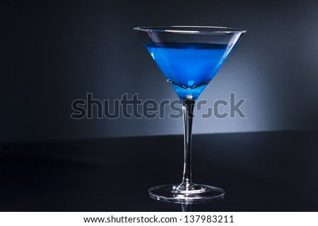 Blue Martini cocktail in an disco setting - stock photo
