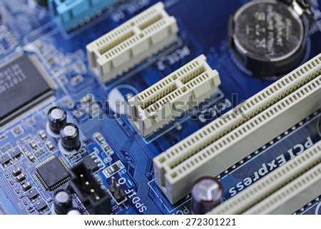 Blue microchip with sockets close up