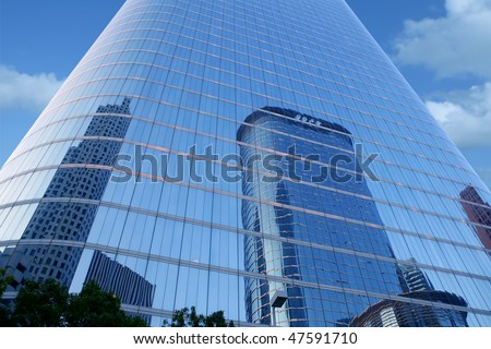 Blue mirror glass facade skyscraper buildings city of Houston Texas - stock photo