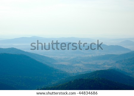 blue mist and fog in the mountains in morning