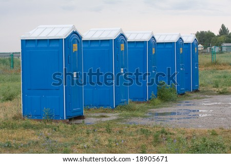 Blue mobile toilet cabins - stock photo
