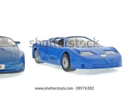 Blue model sports cars isolated on a white background