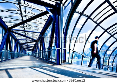 Blue modern corridor, people silhouettes moving - stock photo
