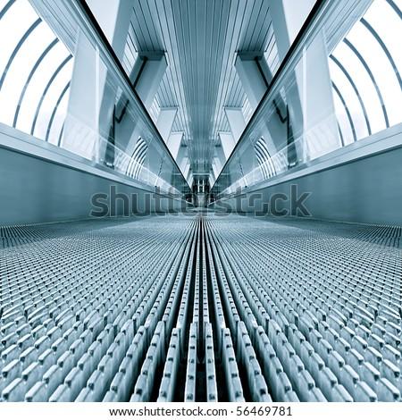 blue modern escalator in business center - stock photo