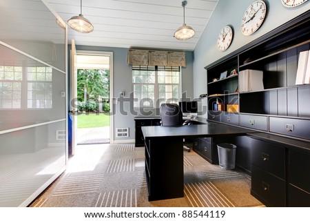 Blue modern home office interior design with dark brown furniture. - stock photo