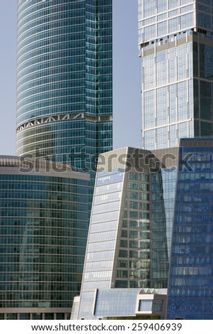 Blue modern office buildings over blue sky - stock photo