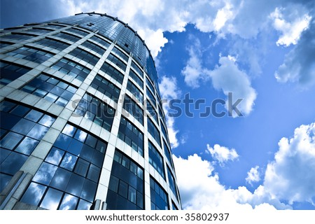Blue modern office skyscraper on sky - stock photo