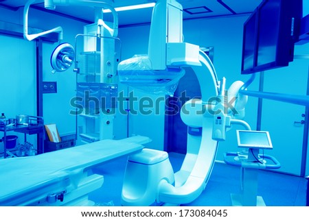 Blue monochromatic interventional operation room - stock photo