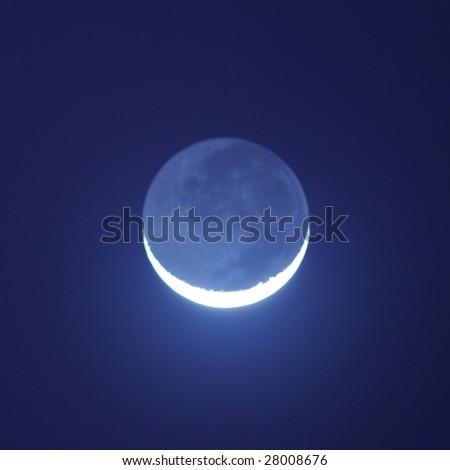 Blue moon shining in the night - stock photo